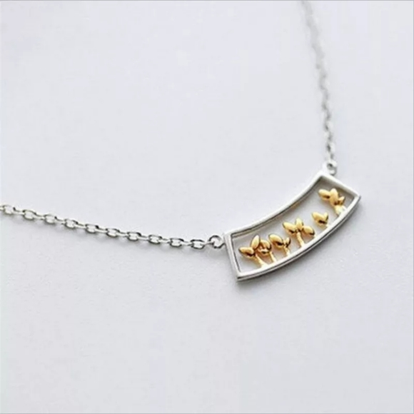 Cute silver and gold plants necklace